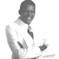 b7f34a - Paul White in a white suit - 1979.jpg