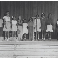 b2f8a - children on the Frolic Theater stage with WJLD mic- 1950.jpg