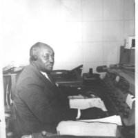 b3f34a - W J Allen, gospel announcer at WEDR console - 1956.jpg