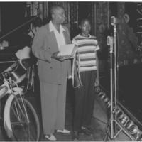 b2f12a - AG Gaston presenting a prize at the Frolic - 1950.jpg