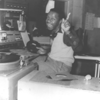 b3f23a - Bruce Payne at the mic at WBCO - 1955.jpg