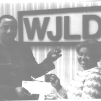 b8f38a - Gary Richardson presenting Yugo keys - 1986.jpg