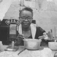 b3f13a - mounted photo of Robelia Pope at WJLD mic - 1954.jpg