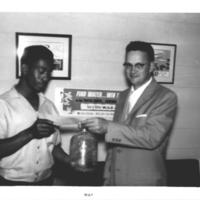 b3f52a - Jim Connolly awarding a prize check at WJLD - May, 1959.jpg